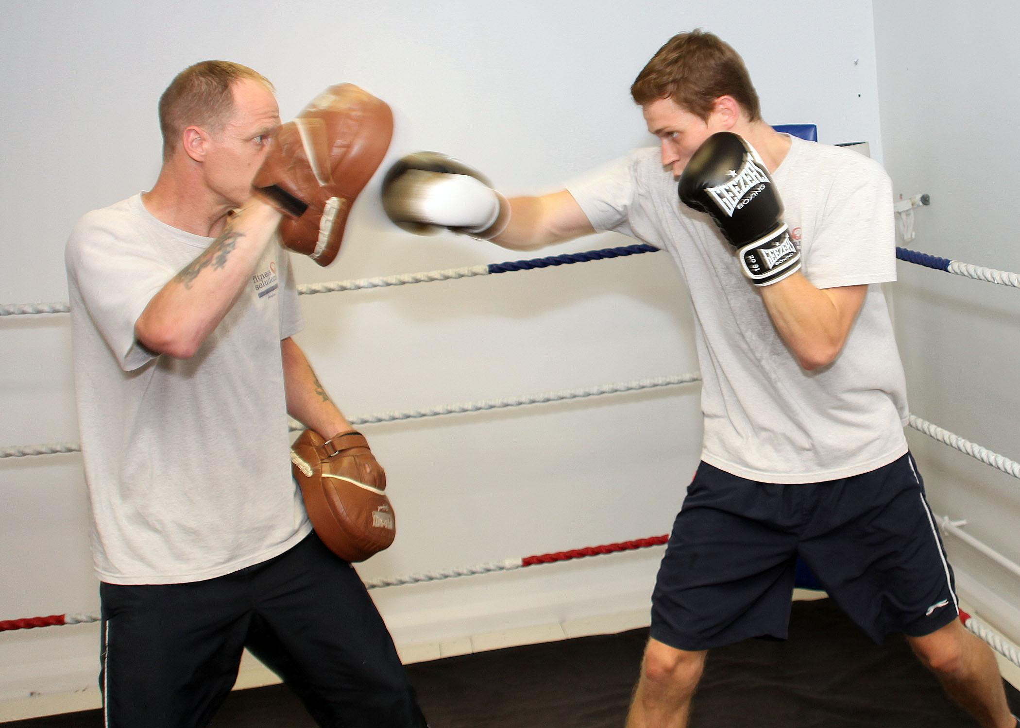 Trainer with trainee boxing